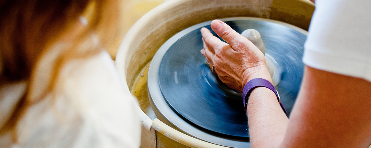 Lady sculpting pottery