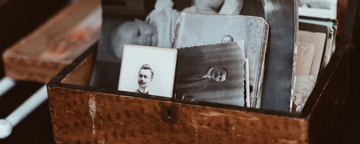 Box of old photos for researching family tree