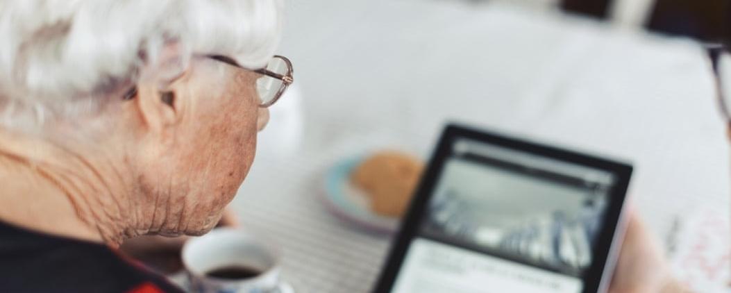 Elderly Woman Using Tablet During National Lockdown