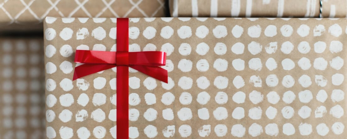 Present wrapped with a red bow